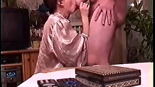 Asian babe is having fun time sucking the guy's big penis.
