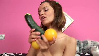 Playful chick with attractive body masturbates with a cucumber and eats it
