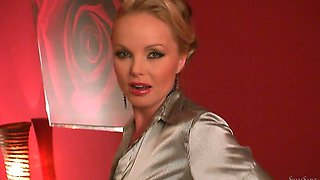 Silvia Saint undresses herself and masturbates