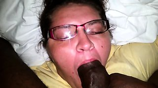 Nerdy brunette chokes on a dark pole and swallows its juices