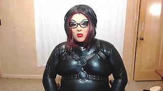 new look shiny female mask and latex looking suit