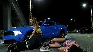 Car loving lesbians kissing passionately on race day