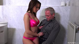 Sexy babe in pink lingerie wants a mature man's penis