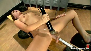 Lily Carter gets fucked by a fucking machine in the locker room