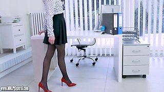 Blonde office slut teases up skirt in nylon suspenders slips panties off and wanks in stilettos