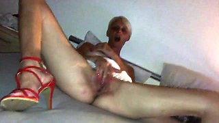 Skinny Old Slag in red high heels take cock in ass