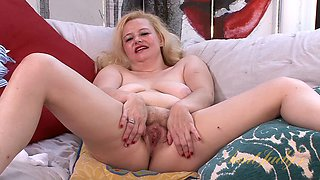 Mature blonde slut spreads her legs to show her pussy