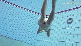 Sexy Pink swimswear babe Lera showing naked body underwater