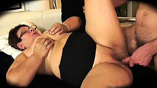 Fat amateur granny with glasses hangs on for a deep pounding