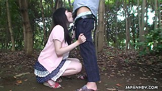 Cute naughty Japanese girl Riko Tanabe is sucking big dick in the park