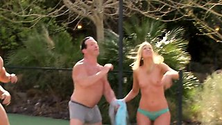 Mature couple strip down to play some fun games by the pool