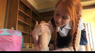 Redhead Schoolgirl and a big Dildo