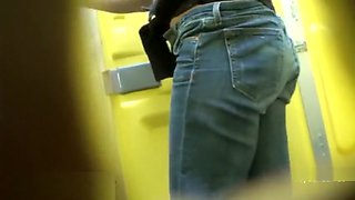 Women and girls pee in the street toilet (close-up)