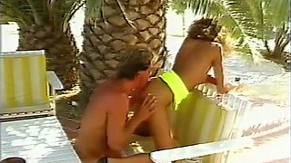 Hot and sassy white classic bimbo sucking dick under the palm tree