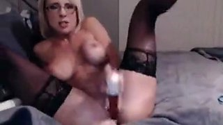 Webcam MILF in glasses with a sexy tight body masturbating her holes