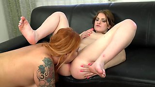 Chubby redhead and young chick have amazing sex on sofa