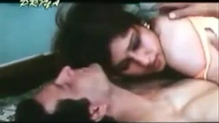 Vintage porn shows a busty Indian slut making out