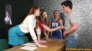 Glamorous cfnm femdoms tugging sub in group