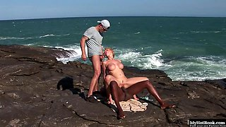 Tarra White is still laying on the beach, naked after her lesbian lovemaking