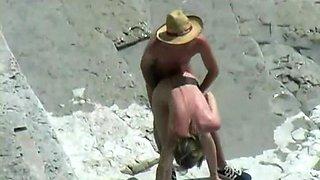 Bare beachgoers caught fucking on cam