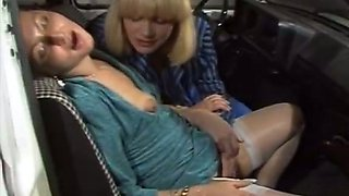 Two horny chicks please each other orally in the front seat of the car