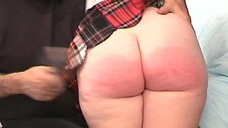 Chubby college girl in uniform gets her pussy toyed and her ass spanked