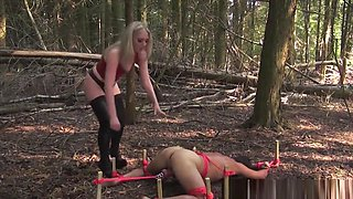 Strapon Mistress Punishing Slave Ass Outdoors