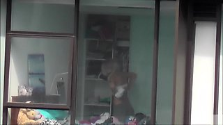 Skinny blonde neighbor walks around her bedroom in underwear