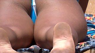 Tanned bootylicious chick wears a really flimsy bikini bottom