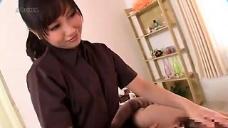 Seductive Oriental masseuse works her gifted hands on a cock