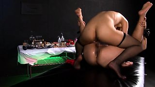 Insatiable Japanese babe in stockings dominates her slave
