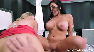 Naughty couple Audrey Bitoni and Johnny Castle are making their girlfriend Katie Kox to suck dick and lick cunt.