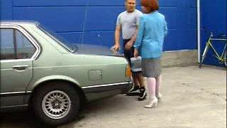 Mature bent over a car