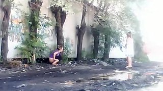 Teens spied pissing outdoors
