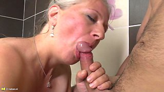 Granny gets in the bathtub with a fit guy that fucks her hard
