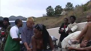 Amazing dirty ebony girl at the outdoor party with a bunch of men