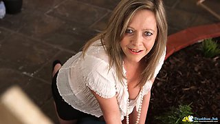 Wrinkled housewife Lou Pierce loves to squeeze her own titties a bit