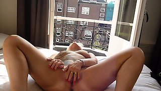 Bodacious blonde milf making herself cum hard on the bed