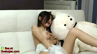 Asian camgirl shows her big natural tits