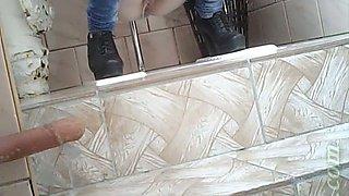 Slender girl in very tight blue jeans filmed in the toilet room