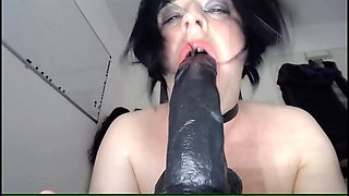 Crossdresser sucks and gags on giant Black Dildo