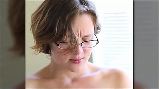 Girl with glasses masturbates and comes