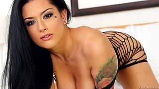 katrina jade shows off her body in a black mesh mini-dress