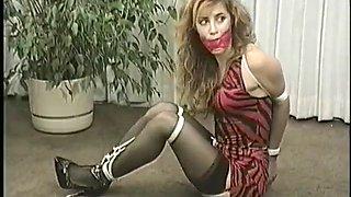 woman bound and ballgagged