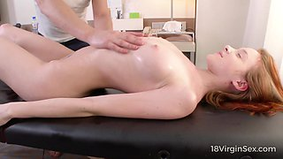 Russian red head Sandra loses her virginity with experienced massage boy