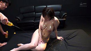 Buxom Asian milf oiled up and made to cum hard by two guys