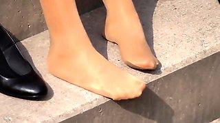 Elegant girls in nylons reveal their lovely feet outside