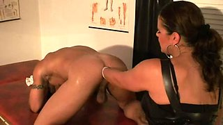 Curvy domina fucks and fists her thrall