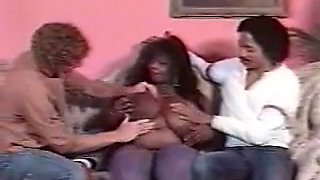 Horny classic BBW brown skin lady on the couch with two men