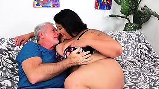 Fat mature brunette braces herself for a wild fuck session